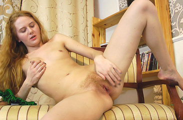 Horny Redhead Nicole K fingers her hairy pussy after sexting