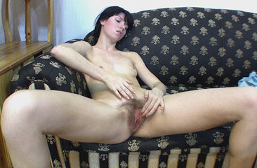 Bonya spreads her hairy pussy on the coffee table