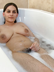 Hairy woman Riani takes a warm bubble bath