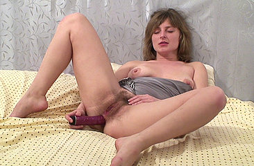 After toying her thick hairy pussy over and over again, sexy natural girl Kate L inserts her vibrator deep into her hairy ass while smiling cheekily.